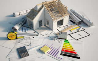 3D renderin of a house under construction on top of blueprints, mortgage forms and a energy efficiency chart